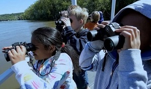 kids on the river with binoculars