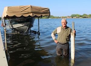 volunteer measuring lake level