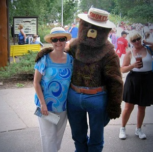 smokey bear at the state fair with a fair goer