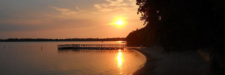 Sunset on a lake shoreline in Minnesota.