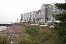 townhomes with a rocky shoreline