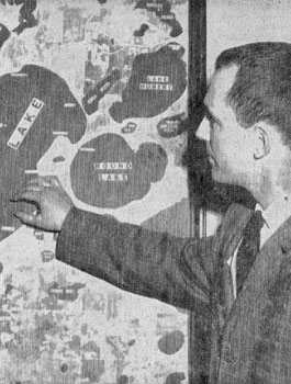 George Orning is displaying a map of the Brainer lakes area that was the focus of his graduate work on shoreland development in 1966. Photo is from the Brainerd Dispatch.