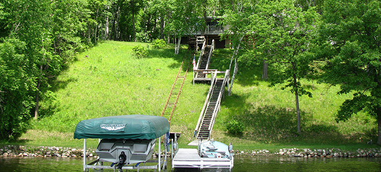 boat, dock and steps leading up to a cabin on gull lake