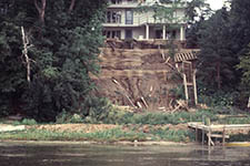 bluff in front of a house. bluff failed and land is sliding into the water