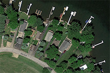 arial view of houses with docks stretching into the water