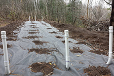 six white posts over a tarp, showing the location of a septic area