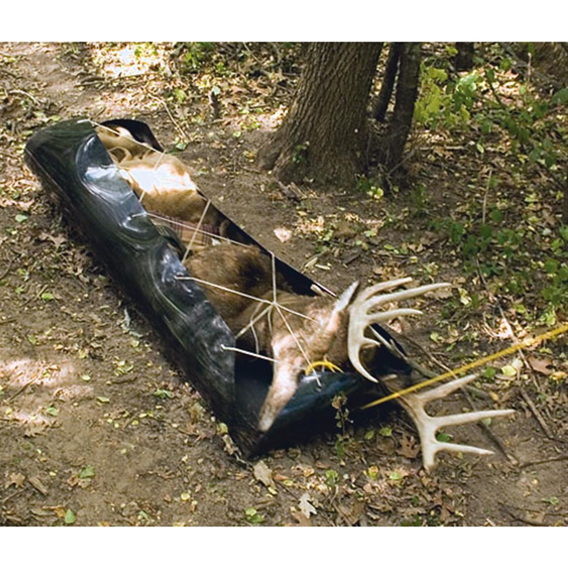 Harvested deer tied on to a sled