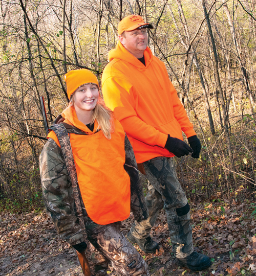 Two deer hunters walking on a trail